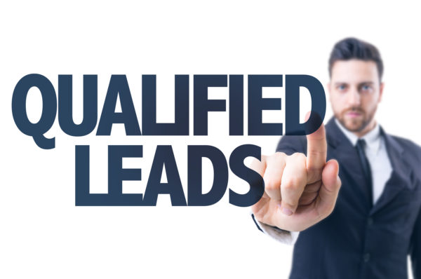 Business man pointing the text: Qualified Leads
